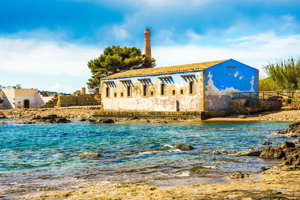 """Noto, Italy - April 2017: the old tuna factory (""""tonnara"""") built by the Ionian Sea in the XVIII century, in the area that is nowadays a natural reserve (Riserva naturale orientata Oasi Faunistica di Vendicari)."""
