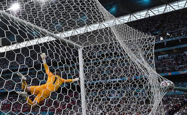 TOPSHOT - England's goalkeeper Jordan Pickford concedes a goal during the UEFA EURO 2020 semi-final football match between England and Denmark at Wembley Stadium in London on July 7, 2021. (Photo by Paul ELLIS / AFP) (Photo by PAUL ELLIS/AFP via Getty Images)