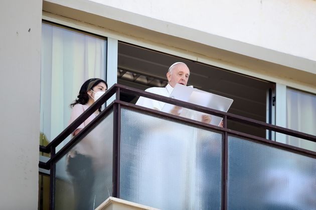 Pope Francis leads the Angelus prayer from a balcony of the Gemelli hospital, as he recovers following scheduled surgery on his colon, in Rome, Italy, July 11, 2021. REUTERS/Yara Nardi