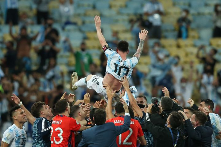 RIO DE JANEIRO, BRAZIL - JULY 10: Argentina players lift their captain Lionel Messi in the air after winning the final of