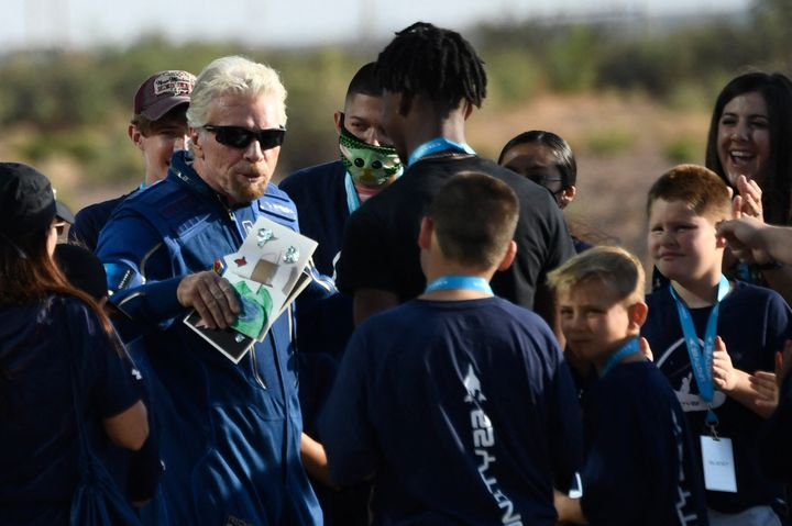 Richard Branson(L) receives some cards from children as he walks out from Spaceport America, near Truth and Consequences, New