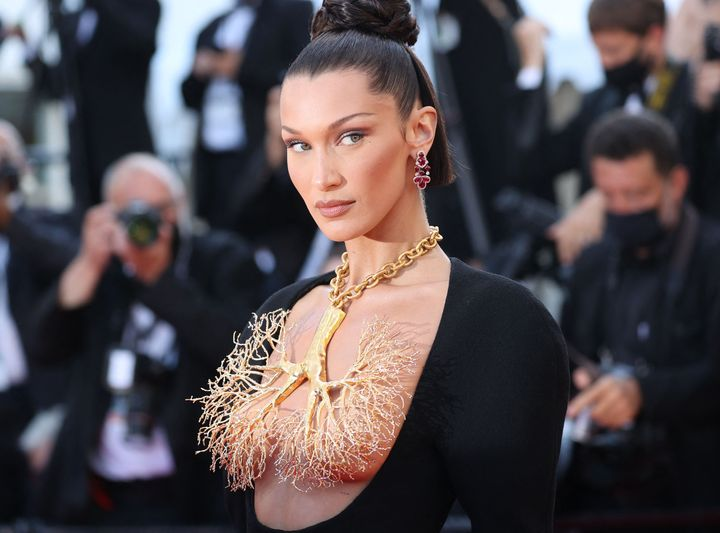 """Bella Hadid poses as she arrives for the screening of the film """"Tre Piani"""" (""""Three Floors"""") at the Cannes Film Festival."""