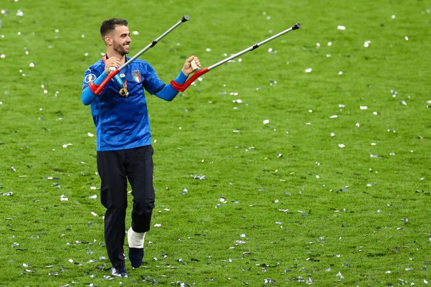 12 July 2021, United Kingdom, London: Football: European Championship, Italy - England, final round, final at Wembley Stadium. Italy's injured Leonardo Spinazzola celebrates after winning the European Championship. Photo: Christian Charisius/dpa (Photo by Christian Charisius/picture alliance via Getty Images)