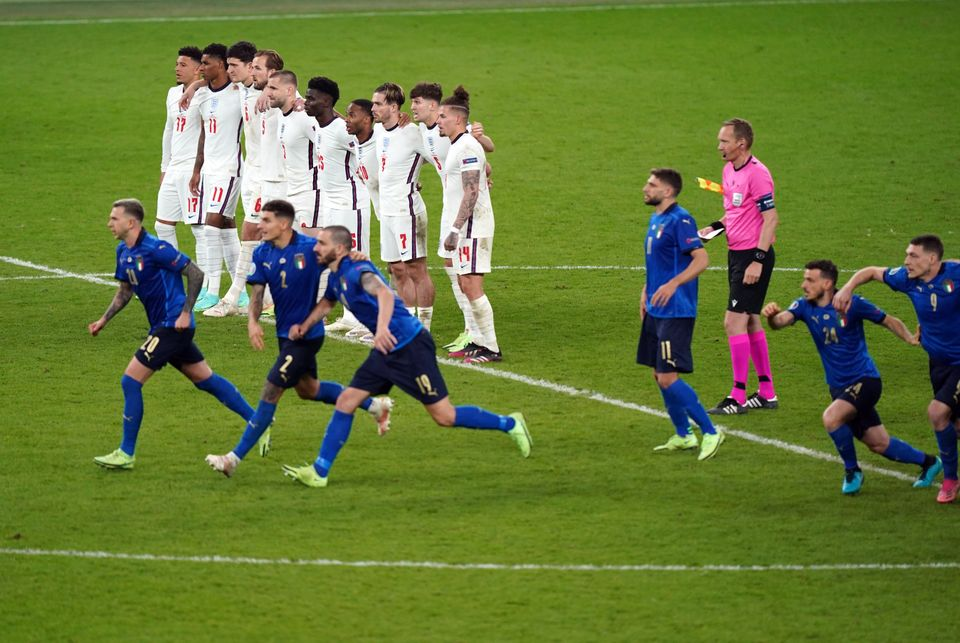 England players look on during the shoot out following the UEFA Euro 2020 Final at Wembley Stadium, London....