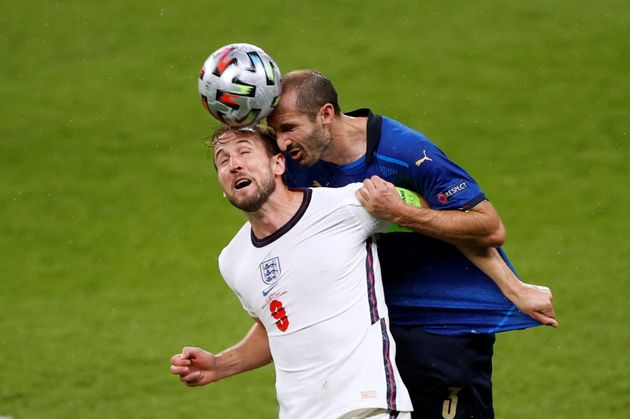 Soccer Football - Euro 2020 - Final - Italy v England - Wembley Stadium, London, Britain - July 11, 2021 Italy's Giorgio Chiellini in action with England's Harry Kane Pool via REUTERS/John Sibley TPX IMAGES OF THE DAY