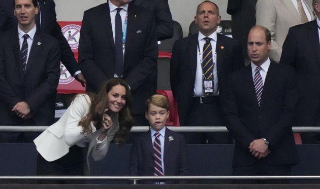 Britain's Catherine (L), Duchess of Cambridge, Prince George of Cambridge (C), and Britain's Prince William...
