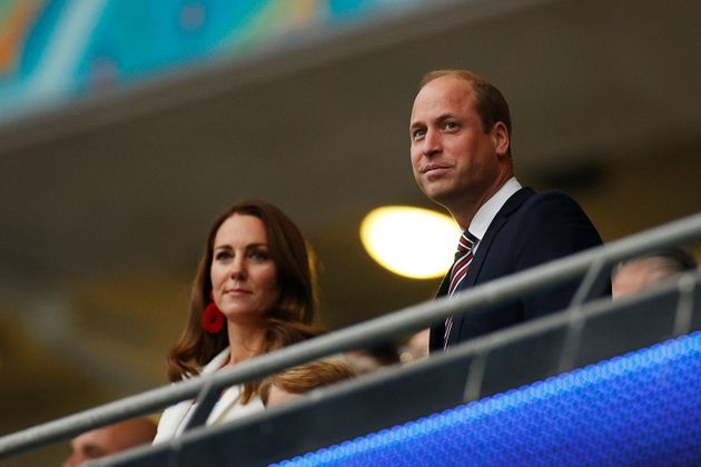 Prince William (R), Duke of Cambridge, and Catherine, Duchess of Cambridge, take their seats ahead of...