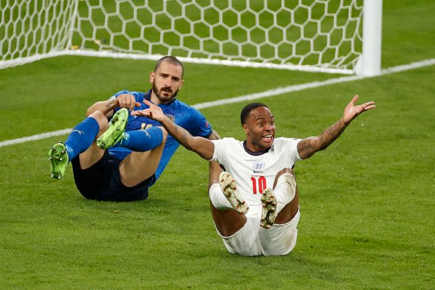 England's forward Raheem Sterling (R) reacts after a challenge by Italy's defender Leonardo Bonucci during...