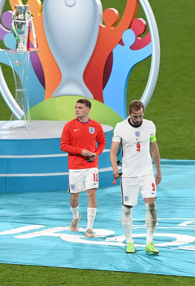 epa09339070 Harry Kane (R) and Kieran Trippier of England walk off the stage after receiving their runner-up...
