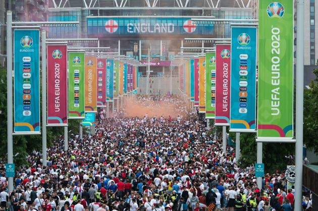 LONDON, UNITED KINGDOM - JULY 11, 2021: Football fans arrive at Wembley Stadium ahead of England match against Italy in the final of Euro 2020 Championship on July 11, 2021 in London, England. The capacity for the final at Wembley has been increased to 65,000 fans making it the biggest crowd at an event in the UK since the outbreak of Covid-19 pandemic as England national team reaches its first tournament final since the 1966 World Cup. (Photo credit should read Wiktor Szymanowicz/Barcroft Media via Getty Images)