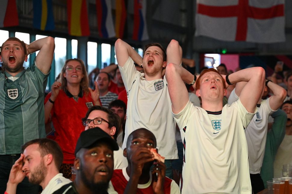 England fans react during the semi-final between England and Denmark