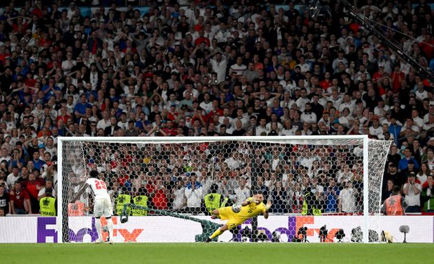 LONDON, ENGLAND - JULY 11: Bukayo Saka of England misses his team's fifth penalty in a penalty shoot out which is saved by Gianluigi Donnarumma of Italy during the penalty shoot out in the UEFA Euro 2020 Championship Final between Italy and England at Wembley Stadium on July 11, 2021 in London, England. (Photo by Paul Ellis - Pool/Getty Images)