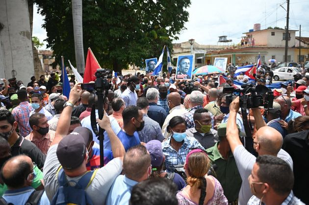Cuban President Miguel Diaz-Canel (C) is seen during a demonstration held by citizens to demand improvements in the country, in San Antonio de los Banos, Cuba, on July 11, 2021. - Thousands of Cubans marched this Sunday, July 11, through the streets of the small town of San Antonio de los Banos in an unprecedented protest against the government, according to videos of fans posted on the internet. (Photo by Yamil LAGE / AFP) (Photo by YAMIL LAGE/AFP via Getty Images)
