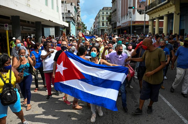 """Thousands of Cubans took part in rare protests Sunday against the communist government, marching through a town chanting """"Dow"""