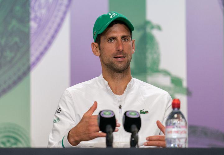 Novak Djokovic attends a press conference after winning his men's singles final match against Matteo Berrettini at Wimbledon