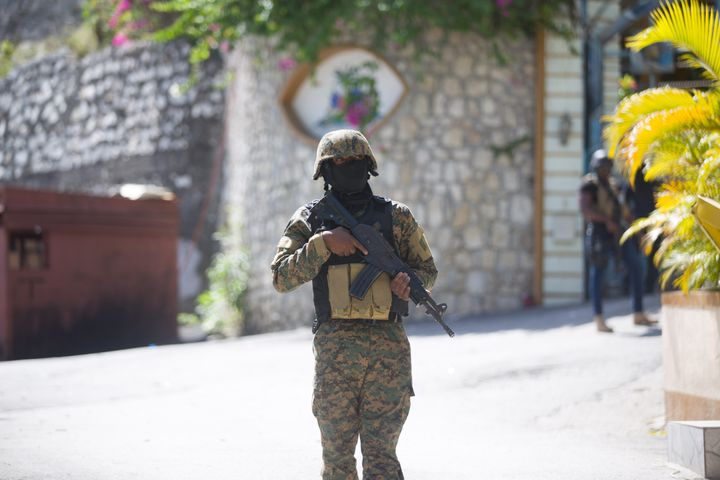 A soldier stands guard in front of Haitian President Jovenel Moise's home in Port-au-Prince, Haiti, on July 7, 2021. (Photo b