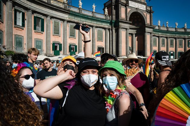 NAPOLI, CAMPANIA, ITALY - 2021/07/03: Girls with make up and accessories with rainbow's color seen in the square. After 25 years since the first event, Napoli Pride was organized in Piazza Dante, in the historical center, for promoting the rights of LGBTQI+ people, with the slogan 'Jesce Sole' (come out sun!). Among the organizers there are several institutions and associations for the LGBTQI+ communitys rights. Among the speakers on the stage there were: Alessandro Zan, a member of the Democratic Party (Partito Democratico), who proposed the homonymous bill to protect discriminatory acts based on sex and gender; the mayor of Naples, Luigi De Magistris; singers Arisa and Paola Turci and writer and politician Vladimir Luxuria. Cola-Cola, Burger King and Deliveroo figure among the sponsor of the event. (Photo by Valeria Ferraro/SOPA Images/LightRocket via Getty Images)