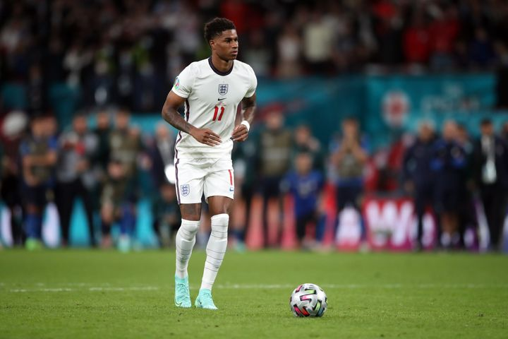 England's Marcus Rashford on the run up to his penalty kick Sunday during the shootout at the UEFA Euro 2020 Final at Wembley Stadium in London.