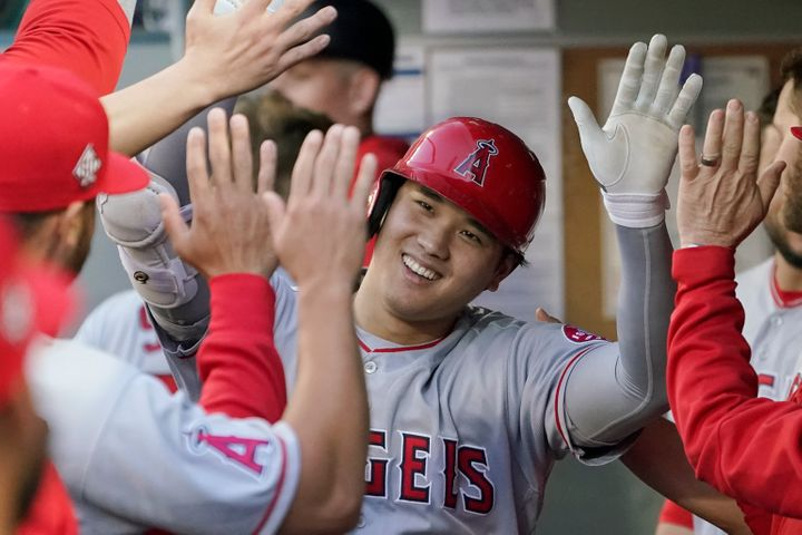 The Los Angeles Angels' Shohei Ohtani is greeted in the dugout after hitting a solo home run on July 9, 2021, in Seattle.&nbs