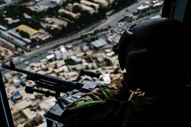 KABUL, AFGHANISTAN -- APRIL 28, 2021: Members of the 777 Special Mission Wing stay vigilant and transport the Chief of General Staff of the Armed Forces Gen. Mohammad Yasin Zia, and fly over Kabul, Afghanistan, Wednesday, April 28, 2021. (MARCUS YAM / LOS ANGELES TIMES)