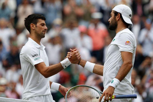 Serbia's Novak Djokovic (L) greets Italy's Matteo Berrettini after winning their men's singles final...
