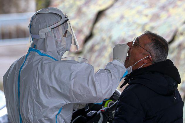MONTERUSCIELLO, POZZUOLI, CAMPANIA, ITALY - 2020/11/17: A doctor swabs a man during the Operation