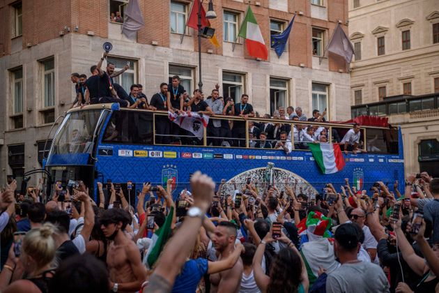 ROME, ITALY - JULY 12: Italy's national men's football team celebrate during an open-top bus victory...