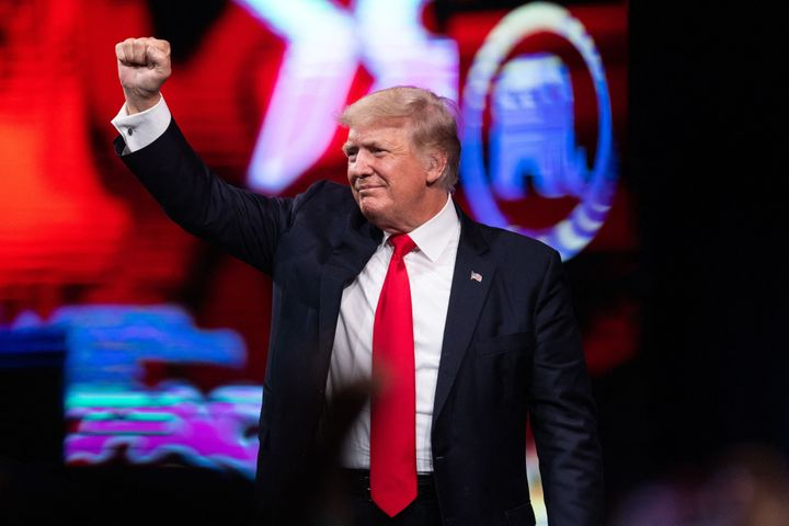 Former President Donald Trump pumps his fist as he walks off after speaking at the Conservative Political Action Conference (