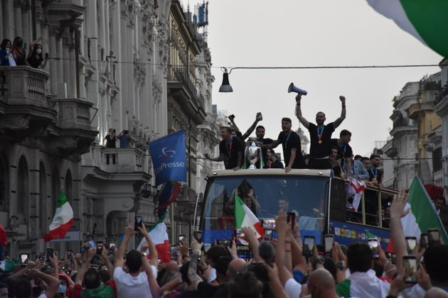 ROME, ITALY, JULY 12: Italy's players celebrate on an open double decker in downtown Rome, Italy on July 12, 2021, after their victory of the UEFA EURO 2020 football tournament in the final played on July 11 at Wembley stadium in London against England. (Photo by Baris Seckin/Anadolu Agency via Getty Images)