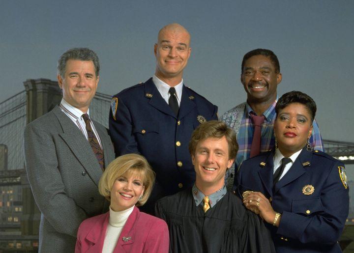 "The cast of ""Night Court"": (l-r) John Larroquette as Dan Fielding, Markie Post as Christine Sullivan, Richard Moll as Nostrad"