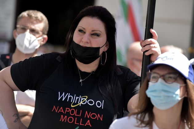ROME, ITALY - MAY 27: Workers of the multinational Whirlpool wear T-shirts with the words 'Napoli non Molla' during the demonstration in Rome against the redundancies and the closure of the Naples plant, on May 27, 2021 in Rome, Italy. (Photo by Simona Granati - Corbis/Corbis via Getty Images)