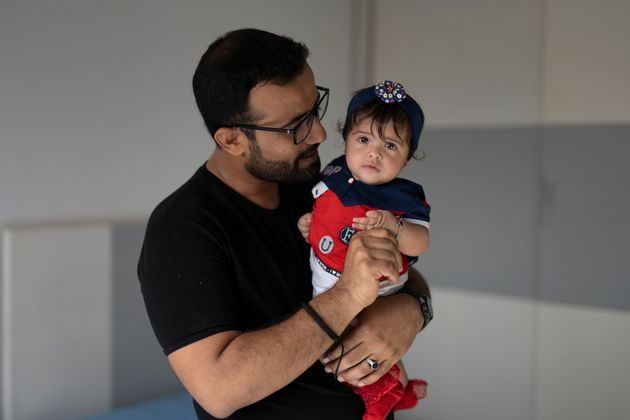 Al-Hasani holds his 6-month-old daughter Massa on July 2, 2021.