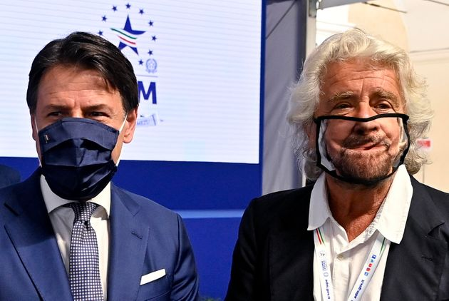 Beppe Grillo (R) with prime minister Giuseppe Conte (L) during the presentation of the 2019 Blue Book at the Customs and Monopolies Agency, Rome, Italy, 11 September 2020. ANSA/RICCARDO ANTIMIANI
