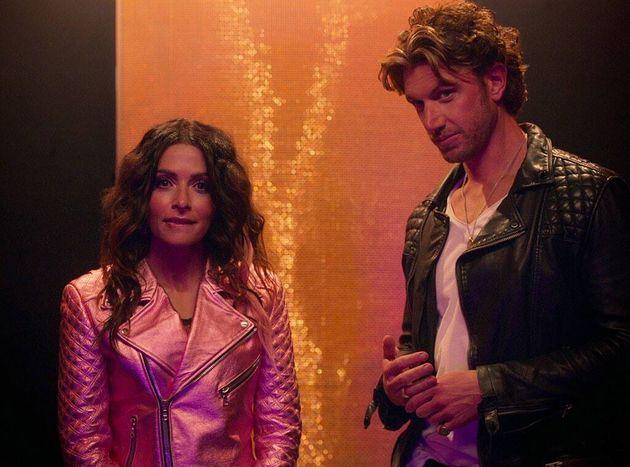 Sarah Shahi and Adam Demos as Billie and Brad in