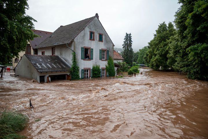 Houses are submerged on the overflowed river banks in Erdorf, Germany.