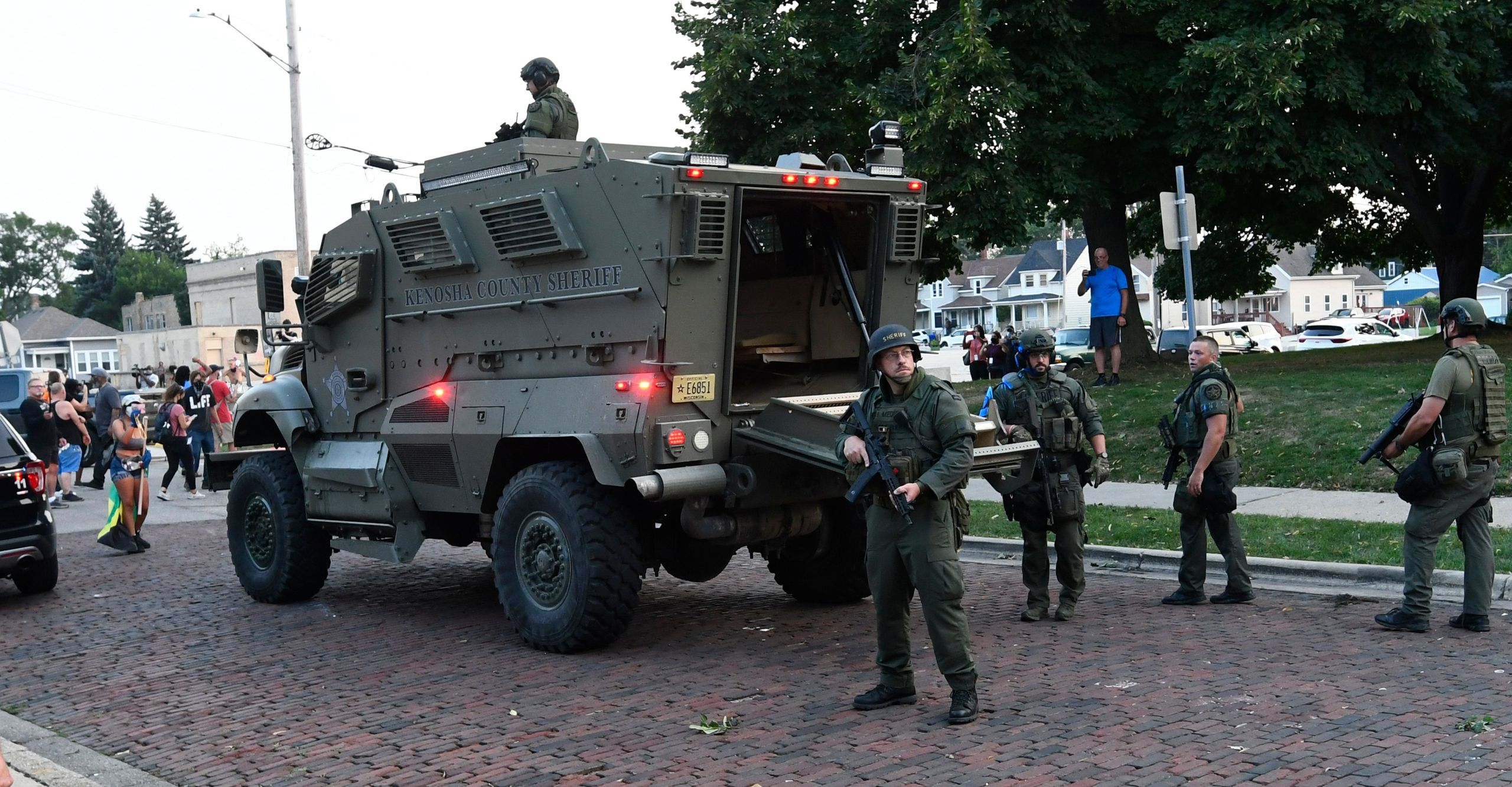Officers arrive at the scene of a protest in a Kenosha County Sheriff's Department armored vehicle on Aug. 26, 2020.