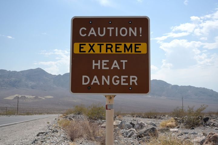 A sign warns of extreme heat in Death Valley, California, where temperatures hit a record 130 degrees Fahrenheit last week.&n