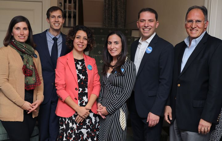 Auchincloss, second from left, and runner-up Jesse Mermell, far left, pose with fellow candidates in October 2019. The field