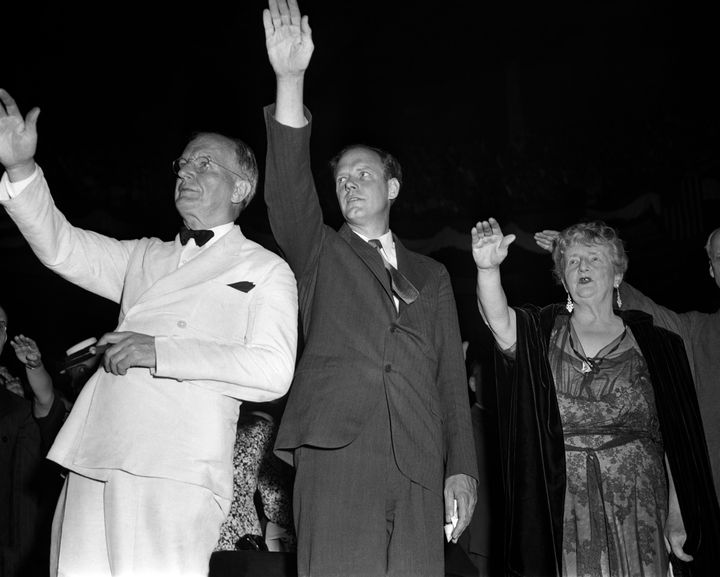 Sen. Burton K. Wheeler, left, aviator Charles Lindbergh and novelist Kathleen Norris pledge allegiance to the flag at an Amer