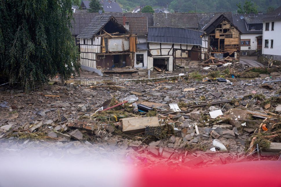 Roads in Schulda, Germany, are littered with debris.