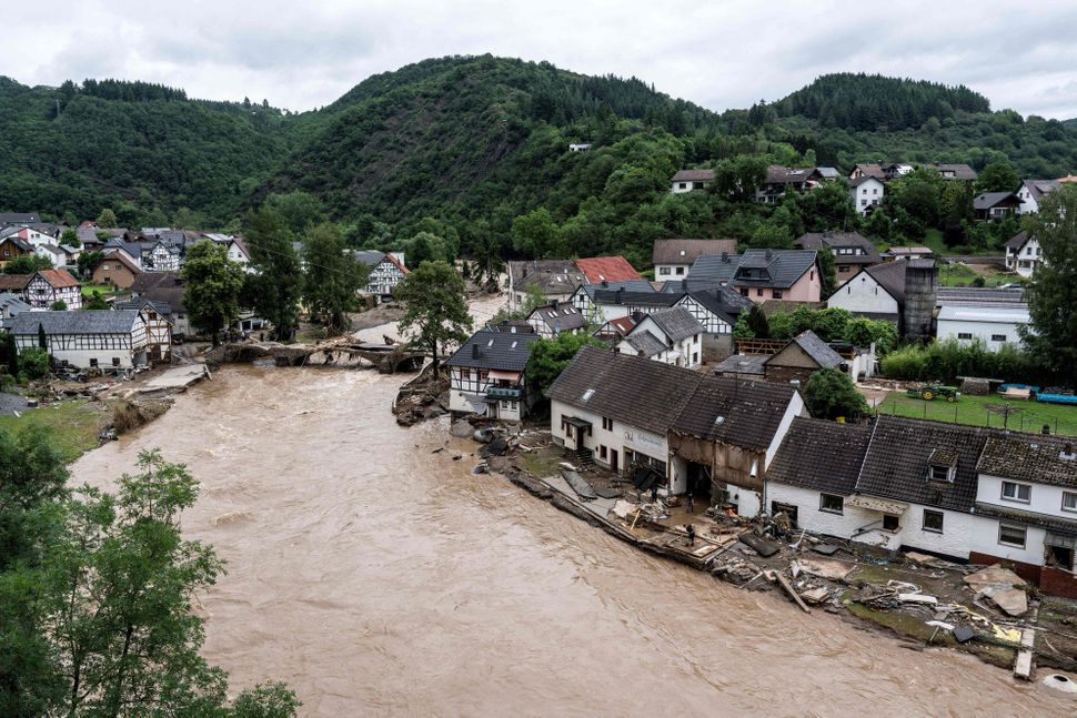 Houses on the banks of the Ahr River in the municipality of Schuld near Bad Neuenahr, western Germany, are flooded after heavy rains.