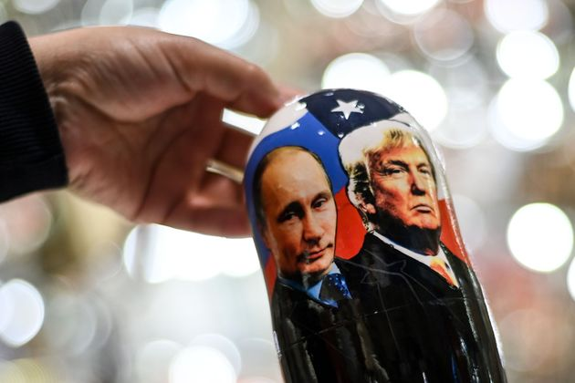A vendor shows a traditional Russian wooden nesting doll, Matryoshka doll, depicting Russia's President Vladimir Putin and US President and Republican presidential nominee Donald Trump at a gift shop in central Moscow on November 3, 2020. (Photo by Kirill KUDRYAVTSEV / AFP) (Photo by KIRILL KUDRYAVTSEV/AFP via Getty Images)