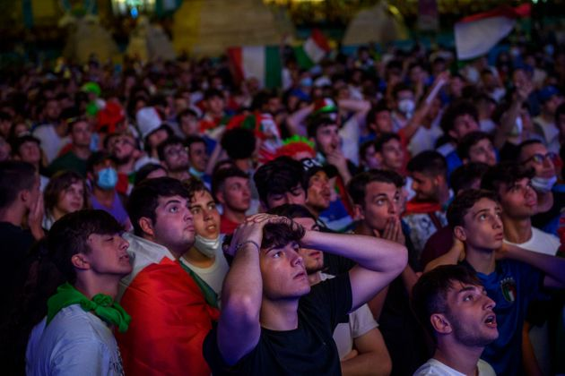 ROME, ITALY - JULY 02: Italian fans react as they watch on giant screens at Piazza del Popolo fan zone...