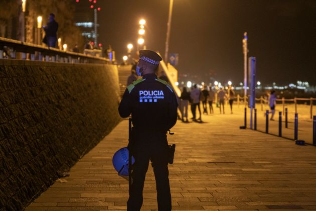 BARCELONA, CATALONIA, SPAIN - MAY 14: A police officer guards the Barceloneta beach during the first...