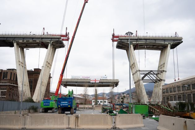 GENOA, ITALY - FEBRUARY 09: The first section of the remains of the Morandi Bridge is being taken down on February 9, 2019 in Genoa. Demolition of the Morandi Bridge begins at Ponte Morandi on February 09, 2019 in Genoa, Italy. The bridge suffered a partial collapse on August 14, 2018. (Photo by Stefania M. D'Alessandro/Getty Images)