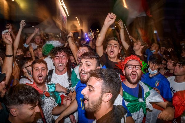 ROME, ITALY - JULY 02: Italian fans celebrate the victory of Italy at Piazza del Popolo fan zone after the Euro 2020 Quarter Final match between Belgium and Italy played at Fussball Arena Muenchen, on July 2, 2021 in Rome, Italy. The winner of this match heads to the UEFA European Football Championship's semi-final match. The tournament was postponed from last year due to the Covid-19 pandemic. (Photo by Antonio Masiello/Getty Images)