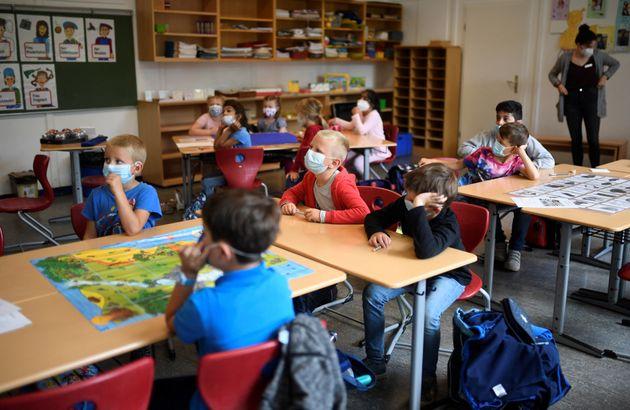 Pupils listen to their teacherat primary school on July 6, 2021.