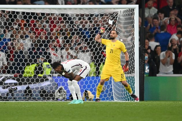 LONDON, ENGLAND - JULY 11: Marcus Rashford of England looks dejected after hitting the post in their...