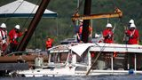 In this July 23, 2018 file photo, a duck boat that sank in Table Rock Lake in Branson, Mo., is raised after it went down the evening of July 19 after a thunderstorm generated near-hurricane strength winds, killing 17 people.