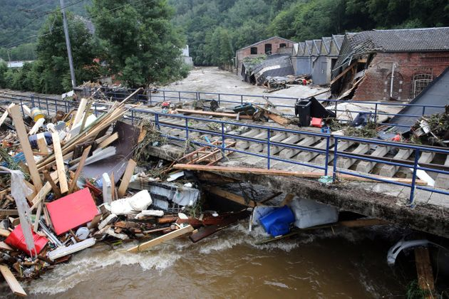 This picture taken in Pepinster on July 16, 2021 shows debris piled up next to a bridge after the flood....